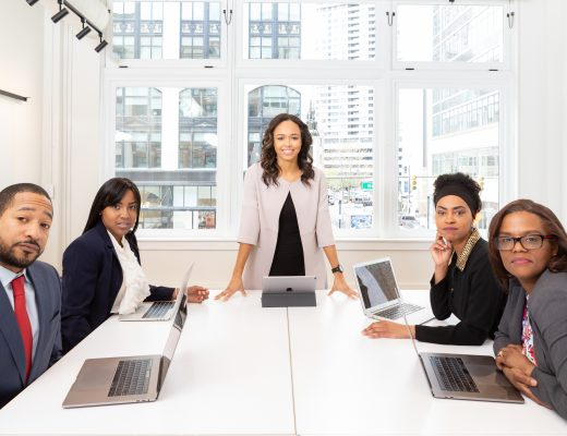 woman-standing-on-the-center-table-with-four-people-on-the-1367271-520x400