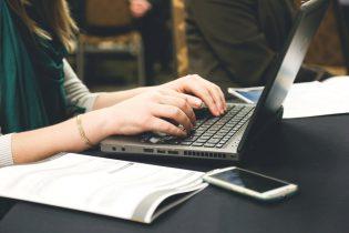 woman-typing-writing-windows-315x210